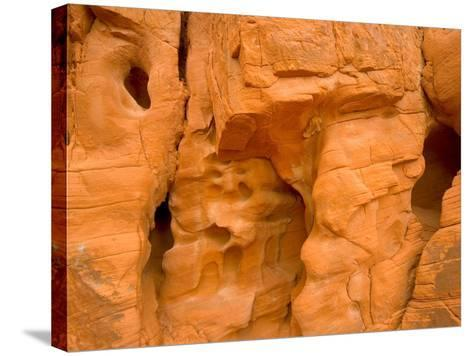 Eroded Sandstone Cliff With Holes-John Eastcott & Yva Momatiuk-Stretched Canvas Print
