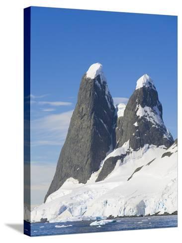 Snowcapped Pinnacles Rising from Coast-John Eastcott & Yva Momatiuk-Stretched Canvas Print