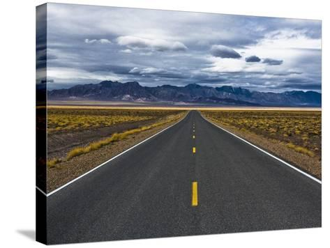 Empty Highway in Death Valley National Park-Rudy Sulgan-Stretched Canvas Print