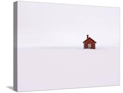 Red Wooden House Surrounded by Snow-Bruno Ehrs-Stretched Canvas Print