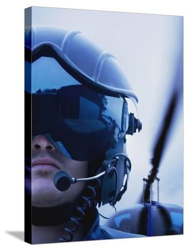 Helicopter Pilot-Bruno Ehrs-Stretched Canvas Print