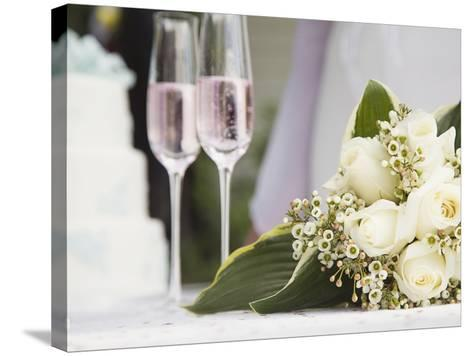 Wedding bouquet and champagne glasses-Marnie Burkhart-Stretched Canvas Print