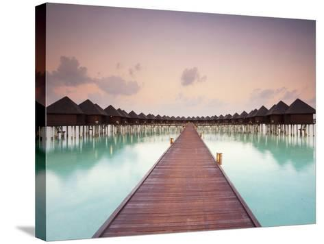 Boardwalk and Water Bungalows after Sunset-Frank Lukasseck-Stretched Canvas Print