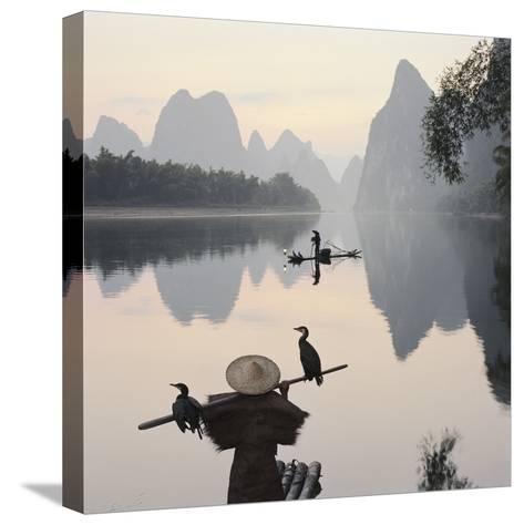 Cormorant fishermen in Li River-Martin Puddy-Stretched Canvas Print