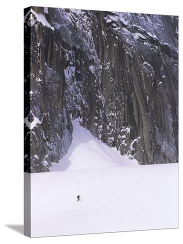 Backcountry Skier Underneath Snowpatch Spire, Bugaboos, British Columbia, Canada.-Chris Joseph-Stretched Canvas Print