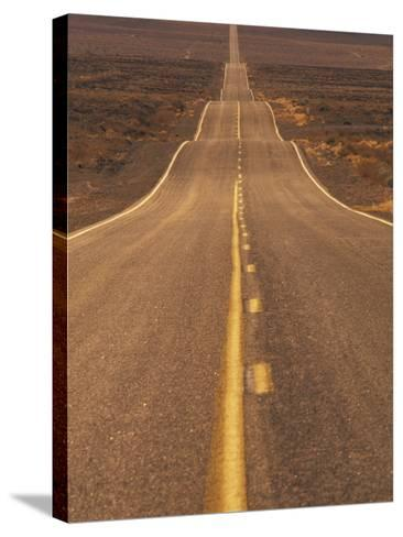 USA, California, Death Valley- Long Shot of Desert Highway-Chris Cheadle-Stretched Canvas Print