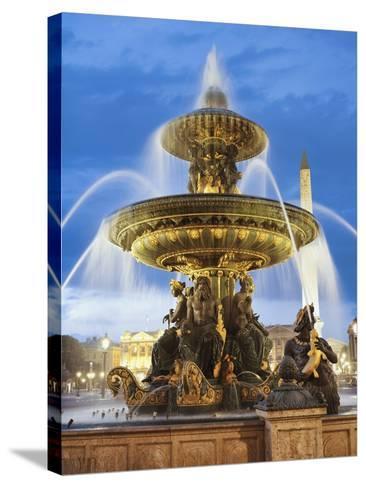 Fountain at The Place de la Concorde-Rudy Sulgan-Stretched Canvas Print