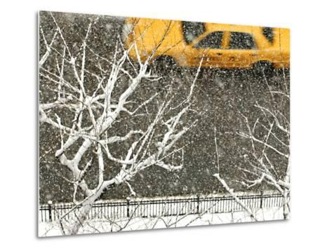 Yellow cab on Park Avenue in a snowstorm-Bo Zaunders-Metal Print