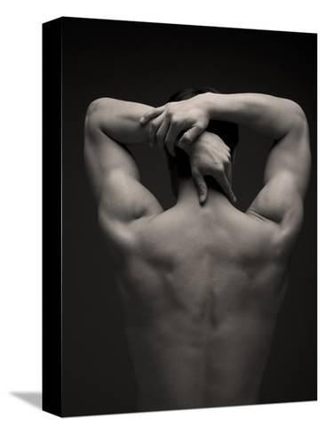Rear View of a Male Stretching His Arm Behind His Head-Sung-Il Kim-Stretched Canvas Print