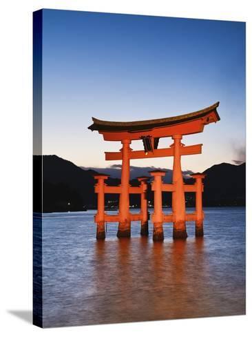 Torii Gate at the Itsukushima Jinga Shrine-Rudy Sulgan-Stretched Canvas Print