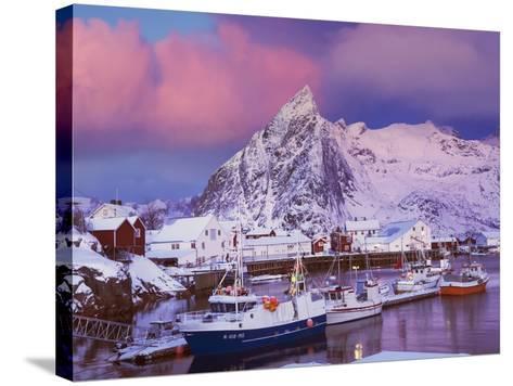 Fishing village of Hamnoy below Klokketinden peak-Frank Krahmer-Stretched Canvas Print