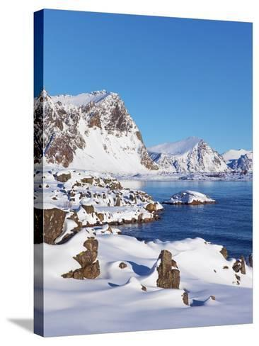 Coastal mountains in the Lofoten Islands in new snow-Frank Krahmer-Stretched Canvas Print