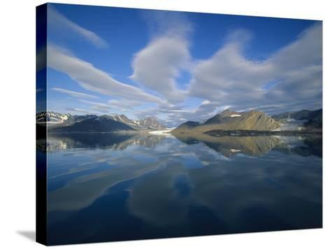 Arctic Skyline Reflecting in Water-Onne van der Wal-Stretched Canvas Print
