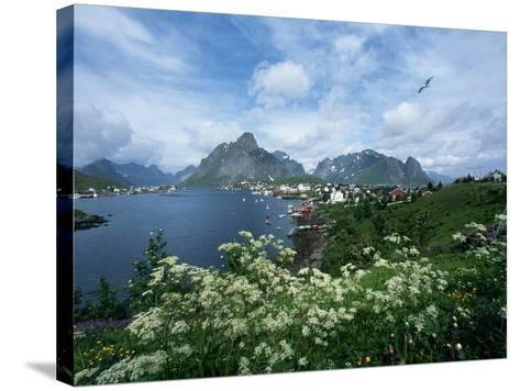 View of Fishing Village and Island-Kevin Schafer-Stretched Canvas Print