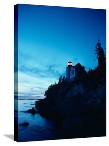 Lighthouse at Dusk-Craig Aurness-Stretched Canvas Print