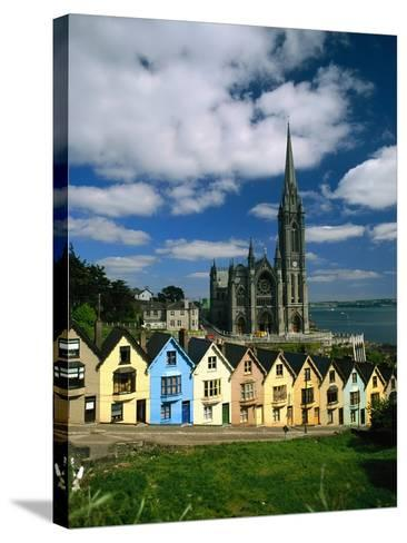 St. Coleman's Cathedral of Cobh Behind Colorful Row Houses-Charles O'Rear-Stretched Canvas Print
