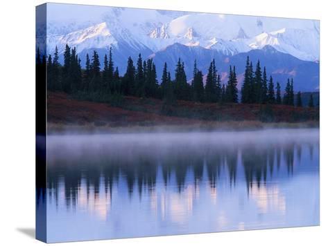 Alaskan Range Reflected in Wonder Lake-Jeff Vanuga-Stretched Canvas Print