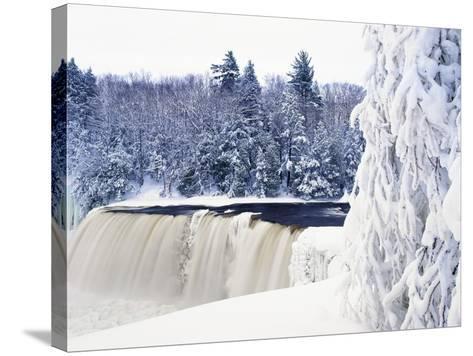 Tahquamenon Falls in Snow-Jim Zuckerman-Stretched Canvas Print