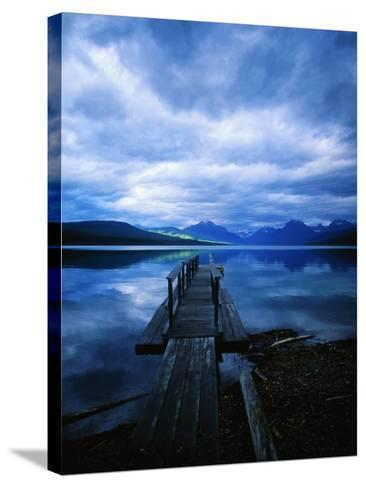 Pier at Lake McDonald Under Clouds-Aaron Horowitz-Stretched Canvas Print
