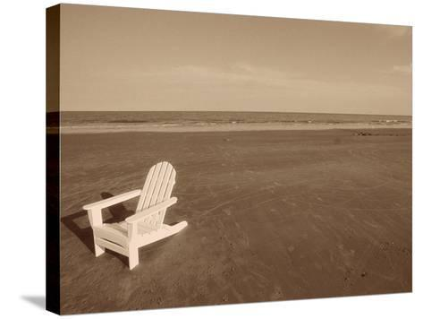 Lone Chair on Empty Beach--Stretched Canvas Print