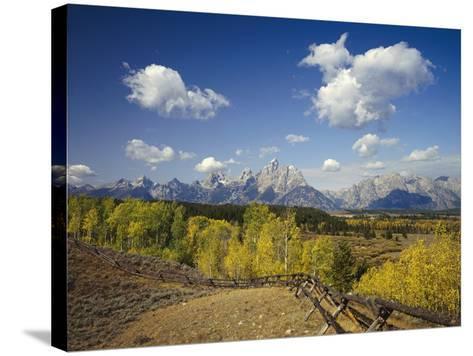 Fence Bordering Ranch Near the Teton Range-Craig Tuttle-Stretched Canvas Print