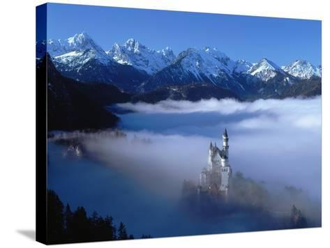 Neuschwanstein Castle Surrounded in Fog-Ray Juno-Stretched Canvas Print