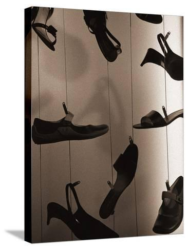 Ladies Shoes Hanging on Wire-Henry Horenstein-Stretched Canvas Print