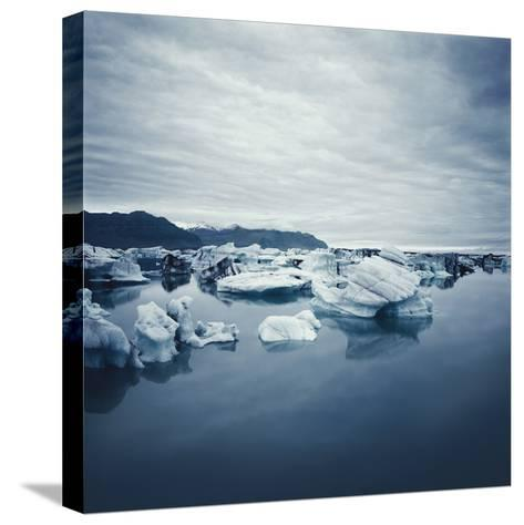 Bergy Bits Under Cloudy Sky--Stretched Canvas Print