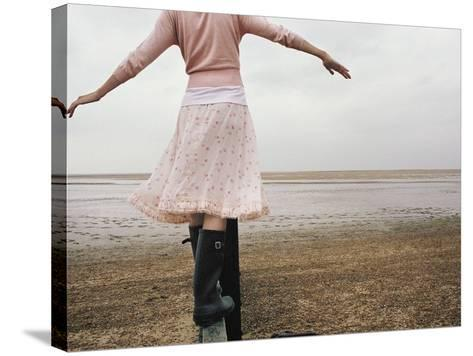 Woman Balancing on a Breakwater--Stretched Canvas Print