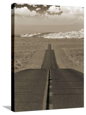 Highway Cutting Through a Desert--Stretched Canvas Print