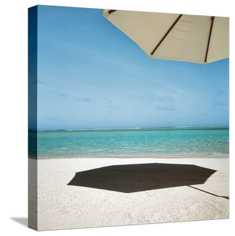 Shadow of Umbrella on the Beach--Stretched Canvas Print