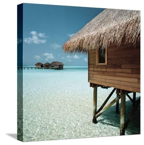 Cabana Raised Above the Ocean--Stretched Canvas Print