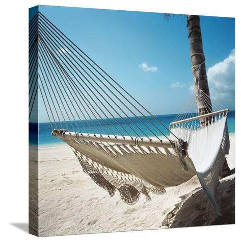 Hammock on a Beach--Stretched Canvas Print