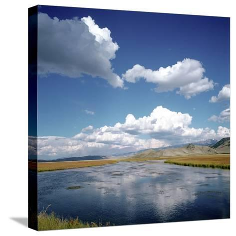River Running Through Countryside--Stretched Canvas Print