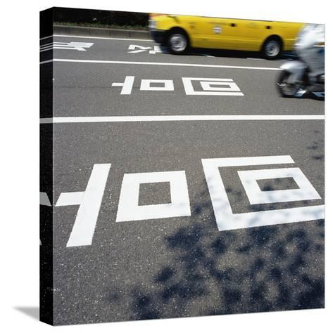 Road markings on a Japanese street--Stretched Canvas Print