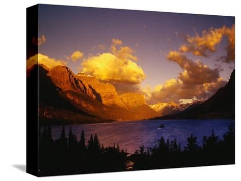 Sunrise over St. Mary Lake-Darrell Gulin-Stretched Canvas Print