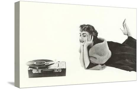 Heavily Browed Lady Listening to Record Player--Stretched Canvas Print