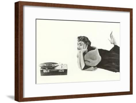 Heavily Browed Lady Listening to Record Player--Framed Art Print