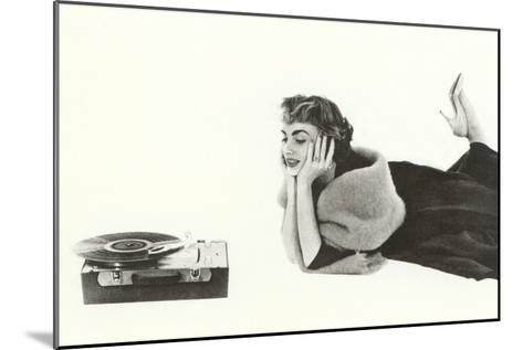 Heavily Browed Lady Listening to Record Player--Mounted Art Print