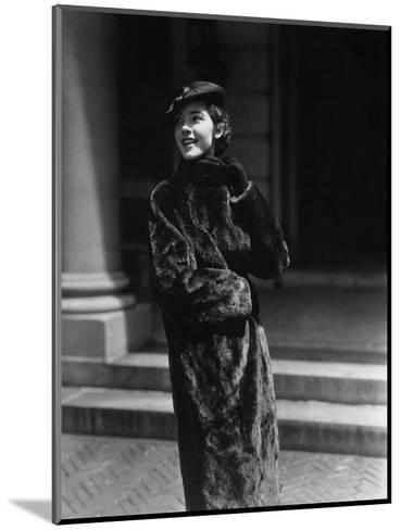 Vogue - August 1934 - Young Woman in Nurtria Fur Coat-Lusha Nelson-Mounted Premium Photographic Print