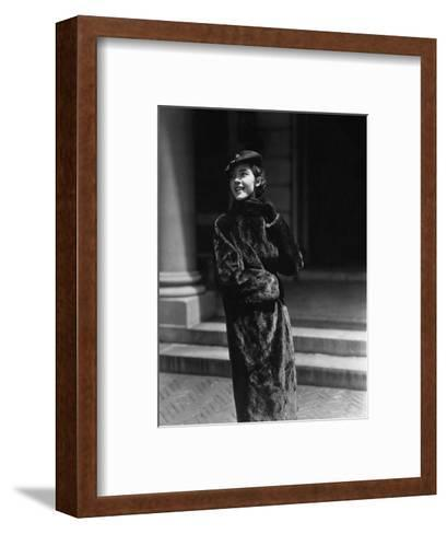 Vogue - August 1934 - Young Woman in Nurtria Fur Coat-Lusha Nelson-Framed Art Print