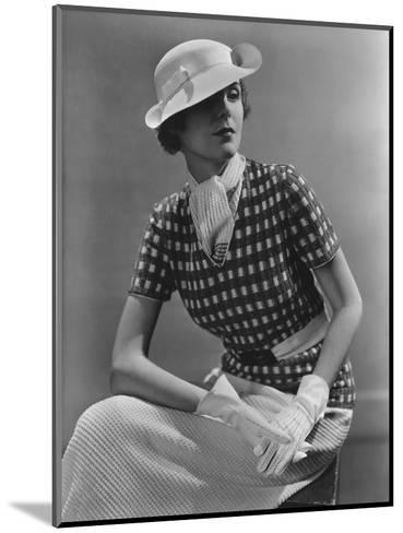 Vogue - January 1935 - Woman in Knitted Sportswear and White Hat-Lusha Nelson-Mounted Premium Photographic Print