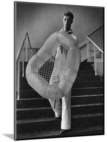 Vogue - July 1944 - William Miller Carrying a Chair he Designed-Karger-Pix-Mounted Premium Photographic Print