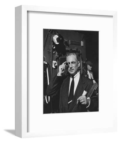 Vogue - February 1952 - Cinematographer on Film Set-Howard Jean-Framed Art Print