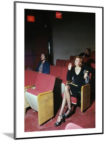 Vogue - September 1972 - Woman in Movie Theater-Kourken Pakchanian-Mounted Premium Photographic Print