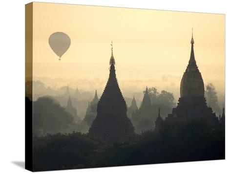Hot Air Balloon over the Temple Complex of Pagan at Dawn, Burma-Brian McGilloway-Stretched Canvas Print