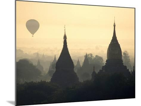 Hot Air Balloon over the Temple Complex of Pagan at Dawn, Burma-Brian McGilloway-Mounted Photographic Print
