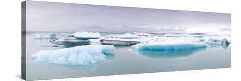 Icebergs Floating on the Jokulsarlon Glacial Lagoon, Iceland, Polar Regions-Lee Frost-Stretched Canvas Print