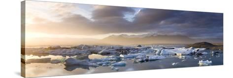 Icebergs Floating on the Jokulsarlon Glacial Lagoon at Sunset, Iceland, Polar Regions-Lee Frost-Stretched Canvas Print