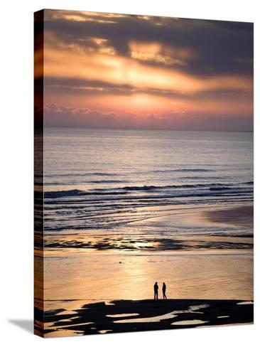 Man and Woman in Silhouette Looking Out Over North Sea at Sunsrise From Alnmouth Beach, England-Lee Frost-Stretched Canvas Print
